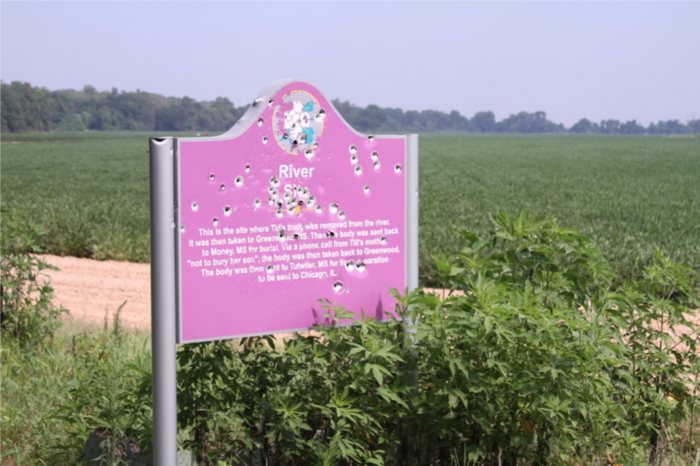 Roadside Emmett Till memorial sign riddled with bullet holes